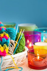 The white basket crochet fabric and colored yarn. Candles in candlesticks color.