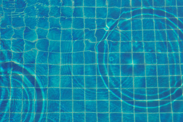 Background of rippled water in swimming pool. top view