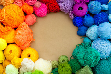 Colorful yarn stacked in a series of colors.