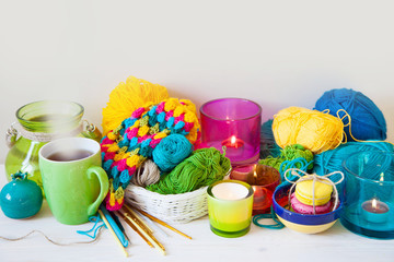 Colored candle holders and yarn for knitting.