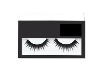 Black eyelashes for makeup on white background.