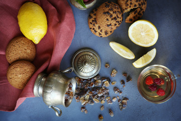 Fresh tea composition with napkin on grey background
