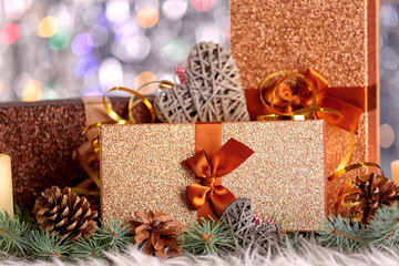 Christmas composition with gift boxes and decorations on bokeh background