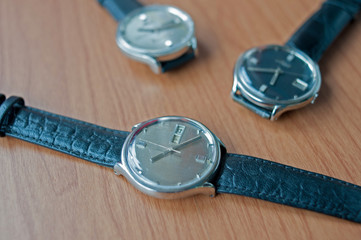 Wrist watches on a wooden table