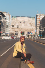 Indian handsome man posing in an urban context