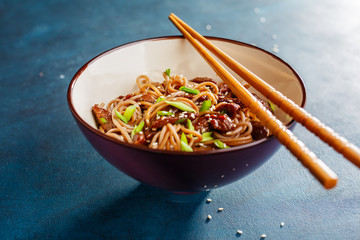 Bowl of soba noodles with beef.
