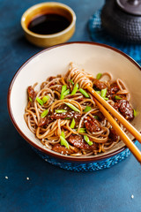 Fried noodles yakisoba with beef in a bowl