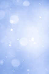 Abstract Blue Christmas Background with Real Snow. Blurred Snowflakes.