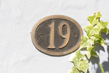 House Number 19 sign on wall