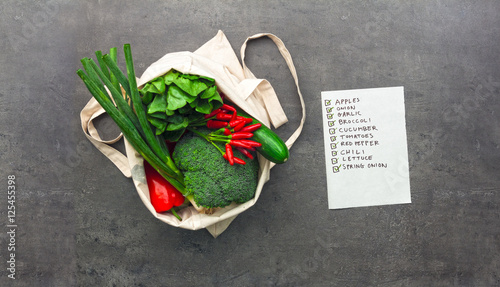 Cotton shopping bag full of vegetables and fruits with checked ...
