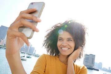 Cheerful woman taking selfie picture in Manhattan