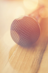 Closeup detail of a microphone with bokeh lights. Soft focus.