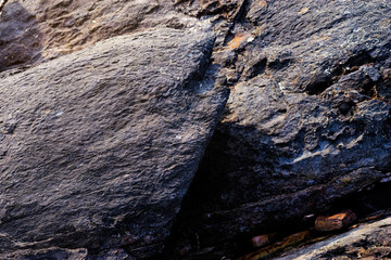 Natural black rock textured backround.