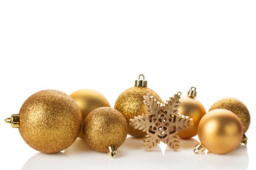 Gold Christmas balls and snowflake isolated on white background