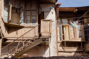 Stairs to poor rustic house in historical city of old Tbilisi