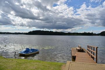 lake landscape with boat ant wooden bridge