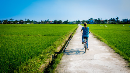 Bicycling in the rice-fields of Hoi An, Vietnam