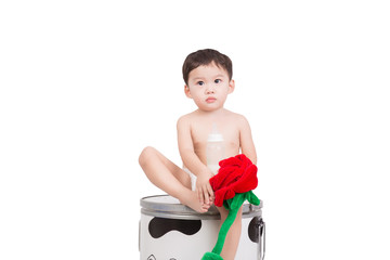 asian baby boy wearing diaper sit down  on bucket isolate on white background.