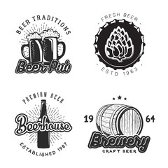 Creative beer set of logos design with mug, bottle, barley and hop elements. Vector illustration. Beer labels used for advertising beverage, brewery, bar, pub or restaurant.
