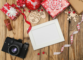 Old camera and frame for photo with christmas decor.