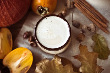 Spicy pumpkin latte on a wooden table