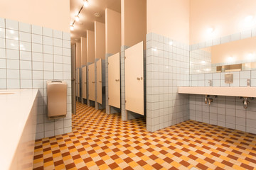Modern interior of the hostel bathroom with toilet cabins