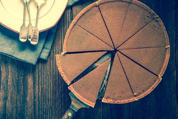 Rich chocolate torte on dark slate