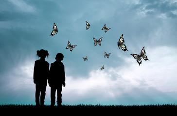 children and butterflies at sunset