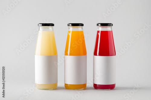 juice bottle mock up three bottles horizontal label stock photo