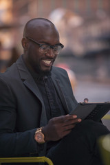 African American man with tablet