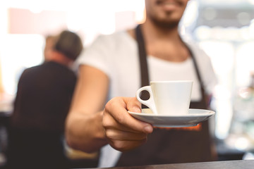 blurred barista holding mug with beverage Wall mural