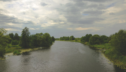 Cloudy summer landscape with river