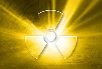 Conceptual shiny glass effect radiation symbol on grunge orange yellow colored illustration background. Concept radioactivity symbol with place for text.