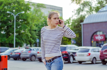 Young woman using her phone