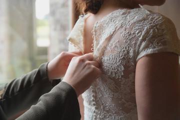 Lacing up a wedding dress