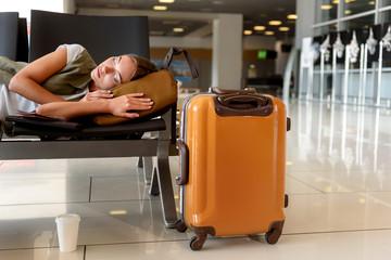 Wall Mural - Beautiful girl napping near luggage