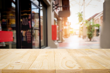Empty wooden table space platform and blurred shopping mall background for product display montage...