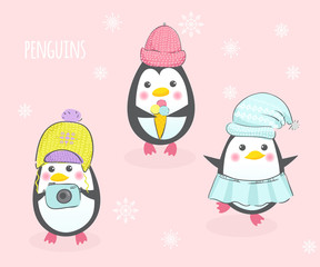Three cute penguins in hats.