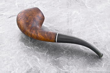Smoking pipe on silver background