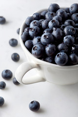 Close-up of blueberries in coffee cup on table