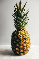 pineapple on white table. white background with copy space