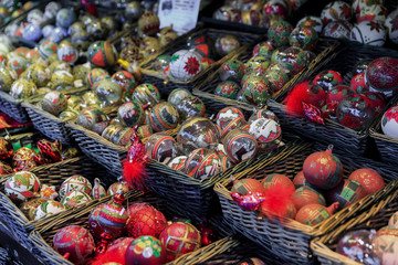 Colorful close up details of christmas fair market. Balls decora