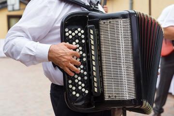 Hand playing accordion closeup