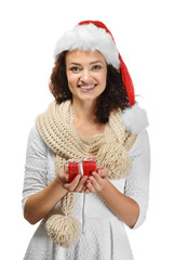Happy woman holding Christmas gift on white background