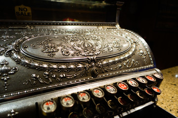 Vintage cash register agaist dark background