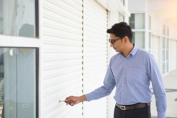 indian business man opening door