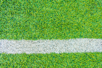 The football field line with artificial grass