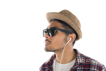 Young hipster man in earphones holding smartphone isolated on th