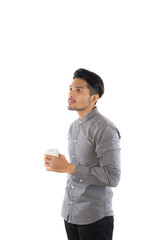 Handsome young hipster man holding coffee cup standing with isol