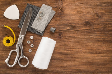 Sewing accessories on wooden background